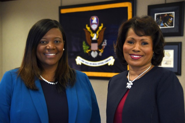 U.S. Army Space and Missile Defense Command/Army Forces Strategic Command employees Erica Ignont, G-8 Execution Division chief, left, and Harriet Clark, senior program analyst, Future Warfare Center, are the command's Civilians of the Year. Clark won the Professional/Technical category and Ignont won the Management category.