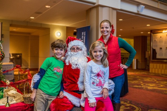 COLUMBUS, Ga. (Dec. 19, 2018) - The Van Aalst Family, Hugh, left, Ava, center, and Katie, background, pose with Santa Clause. Gold Star Families attend the Fort Benning Gold Star Holiday Event at the River Center for the Performing Arts in Columbus, Georgia, Dec. 15. The annual event serves as a reminder that Fort Benning remains committed to taking care of the Family members of service members who have passed away. (U.S. Army photo by Patrick Albright, Maneuver Center of Excellence, Fort Benning Public Affairs)
