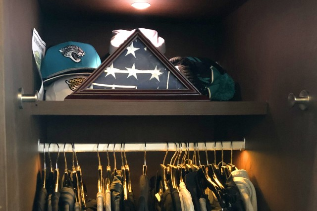 Former Sgt. Sean Karpf, a strength and conditioning associate for the Jacksonville Jaguars, gave U.S. flags encased in shadow boxes to players who support the local community, including veterans and their families.
