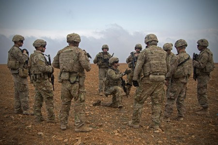 U.S. Soldiers gather for a brief during a combined joint patrol rehearsal in Manbij, Syria, Nov. 7, 2018. Continued assistance to partner forces is essential for setting conditions for regional stability. The Coalition and its partners remain united and resolved to prevent the resurgence of ISIS and its violent extremist ideology.  (U.S. Army photo by Spc. Zoe Garbarino)