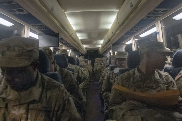 Trainees wait onboard the first buses to leave Fort Jackson on holiday block leave Dec. 18. The buses would depart the installation just before midnight signaling the start of the Army's holiday season. Nearly 7,000 Soldiers would ultimately depart the installation.