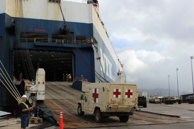 25th Infantry Division Soldiers drive vehicles destined for Pacific Pathways exercises onto the vessel on Jan. 21. (Photo by Donna Klapakis, 599th Transportation Brigade Public Affairs)