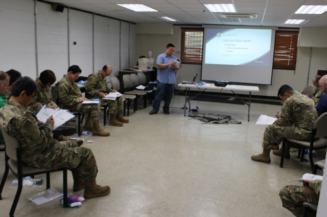 599th traffic management specialist, Jimmy Quilon, leads a first aid and cardiopulmonary resuscitation class at the 837th Transportation Battalion in South Korea on April 30.