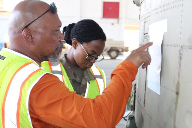 599th traffic management specialist Frank Viray and cargo specialist Spc. Nashelle Mendez check the lading numbers on helicopters at Kalaeloa Airfield on June 11.