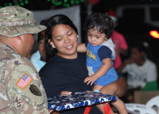 Army Reserve Soldiers give holiday cheer at Saipan fair