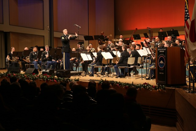 """First Sgt. Ryan Knight, commander of the U.S. Army Japan Band, conducts the band during the sixth annual holiday concert, this year titled """"An American Christmas,"""" held Dec. 15 at Harmony Hall Zama."""