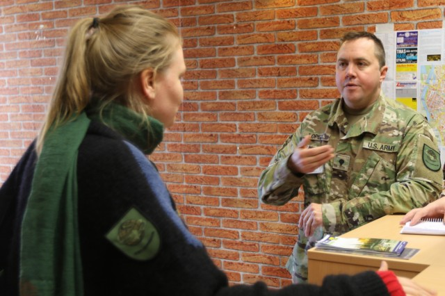 Spc. Jonathan Lopez, civil affairs specialist, 457th Civil Affairs Battalion, works with a roleplayer to address concerns in the local community during Joint Cooperation 18, Nov. 9-16, in Nienburg, Germany. Joint Cooperation is NATO's largest civil-military exercise in Europe. The exercise places military, civilian, and non-governmental agencies in the fictional country of Framland which has requested NATO assistance under Article 4 of the treaty.