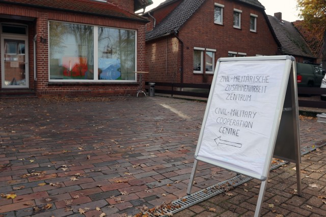 A sign indicates the location of a civil-military cooperation center in Nienburg, Germany, Nov. 14, during Joint Cooperation 18, Nov. 9-16. Joint Cooperation is NATO's largest civil-military exercise in Europe. The exercise places military, civilian, and non-governmental agencies in the fictional country of Framland which has requested NATO assistance under Article 4 of the treaty.