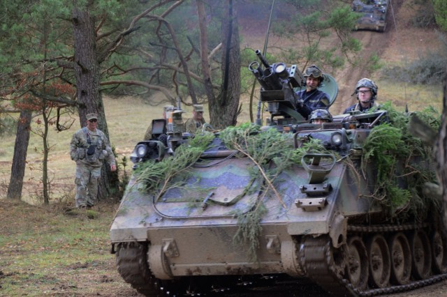 U.S. Soldiers assigned to 1st Battalion of the 4th Infantry Regiment maneuver a M113A3 armored personnel carrier during exercise Combined Resolve XI at Hohenfels Training Area, Germany, Dec. 7, 2018. Combined Resolve XI is a biannual exercise that serves as the combat training center certification exercise for regionally allocated forces. This iteration of the exercise takes place in two phases at the Grafenwoehr and Hohenfels training areas between Nov. 26 - Dec. 14, 2018 and Jan. 13 - 25, 2019.