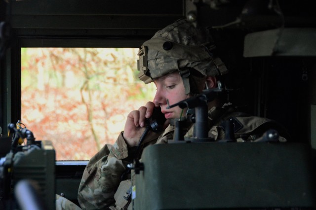 U.S. Army Spc. Hannah Zischler, assigned to Battery C, 1-174 Air Defense Artillery Regiment monitor the radio during exercise Combined Resolve XI at Hohenfels Training Area, Germany, Dec. 7, 2018. Combined Resolve XI is a biannual exercise that serves as the combat training center certification exercise for regionally allocated forces. This iteration of the exercise takes place in two phases at the Grafenwoehr and Hohenfels training areas between Nov. 26 - Dec. 14, 2018 and Jan. 13 - 25, 2019.