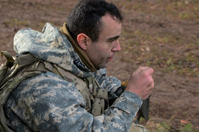U.S. Army Staff Sgt. Keaton Mcginniss, assigned to Battery C, 1-174 Air Defense Artillery Regiment consume an meal ready to eat during exercise Combined Resolve XI at Hohenfels Training Area, Germany, Dec. 7, 2018. Combined Resolve XI is a biannual exercise that serves as the combat training center certification exercise for regionally allocated forces. This iteration of the exercise takes place in two phases at the Grafenwoehr and Hohenfels training areas between Nov. 26 - Dec. 14, 2018 and Jan. 13 - 25, 2019.