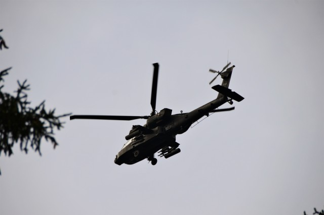A AH-64 Apache fly over Hohenfels during exercise Combined Resolve XI at Hohenfels Training Area, Germany, Dec. 7, 2018. Combined Resolve XI is a biannual exercise that serves as the combat training center certification exercise for regionally allocated forces. This iteration of the exercise takes place in two phases at the Grafenwoehr and Hohenfels training areas between Nov. 26 - Dec. 14, 2018 and Jan. 13 -  25, 2019.