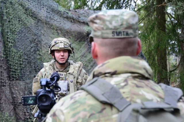 Capt Aaron Smith, the 174 Air Defense Artillery Brigade Public Affairs Officer interview Battery C, 1- 174 Air Defense Artillery Regiment, Battery Commander, Capt. Christopher Vasquez during exercise Combined Resolve XI at Hohenfels Training Area, Germany, Dec. 7, 2018. Combined Resolve XI is a biannual exercise that serves as the combat training center certification exercise for regionally allocated forces. This iteration of the exercise takes place in two phases at the Grafenwoehr and Hohenfels training areas between Nov. 26 - Dec. 14, 2018 and Jan. 13 - 25, 2019.