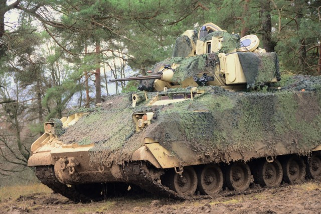 A Bradley fighting vehicle provide security for Battery C, 1-174 Air Defense Artillery Regiment during exercise Combined Resolve XI at Hohenfels Training Area, Germany, Dec. 7, 2018. Combined Resolve XI is a biannual exercise that serves as the combat training center certification exercise for regionally allocated forces. This iteration of the exercise takes place in two phases at the Grafenwoehr and Hohenfels training areas between Nov. 26 - Dec. 14, 2018 and Jan. 13 - 25, 2019.