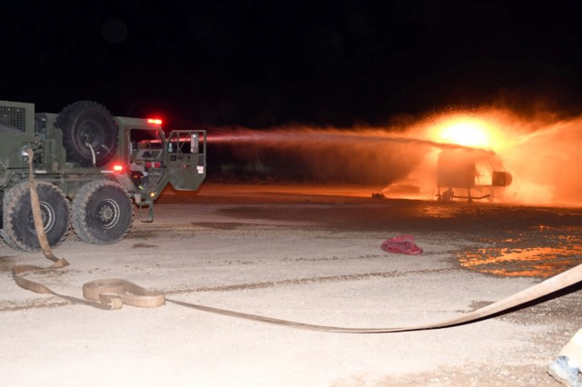 M1142 Tactical Fire Fighting Trucks unleash a dual stream of pressurized water onto the downed helicopter fire simulator during the units' nighttime portion of their search and rescue training exercises conducted at White Sands Missile Range, New Mexico, Dec. 19, 2018. The National Guard firefighter detachments have been taking part in their military rehearsal and validation exercises in order to augment their readiness posture for their upcoming mobilizations to Eastern Europe.