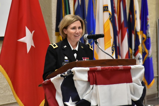 Brig. Gen. Michelle M.T. Letcher provides remarks to Family, friends, distinguished community guests, and Rock Island Arsenal staff members during Rhonda VanDeCasteele's official retirement ceremony at the Rock Island Arsenal, Dec. 20.
