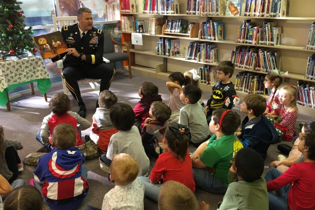 "U.S. Army Operational Test Command Commander Brig. Gen. William D. Hank"" Taylor reads ""Twas the Night Before Christmas"" Thursday to Kindergarteners at Florence Elementary School, Florence, Texas, as part of Fort Hood, Texas' Adopt-A-School program."