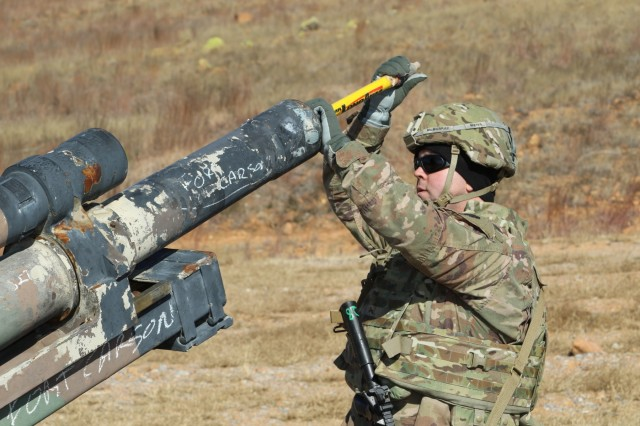 Explosive ordnance disposal team leader, Staff Sgt. Ryan McMurray, with the 752nd Ordnance Company out of Fort Hood, Texas, uses a pole to identify the precise location of an artillery round lodged the barrel of an artillery weapon system as part of a stuck round scenario during the largest 71st Ordnance Group (EOD) Team of the Year competition held at Fort Sill, Okla., Dec. 2-7, 2018. The week-long competition included intense EOD-specific training scenarios designed to be realistic and challenging. The winning team will advance to the Department of the Army EOD Team of the Year competition. (U.S. Army photo by Staff Sgt. Lance Pounds, 71st Ordnance Group (EOD), Public Affairs)