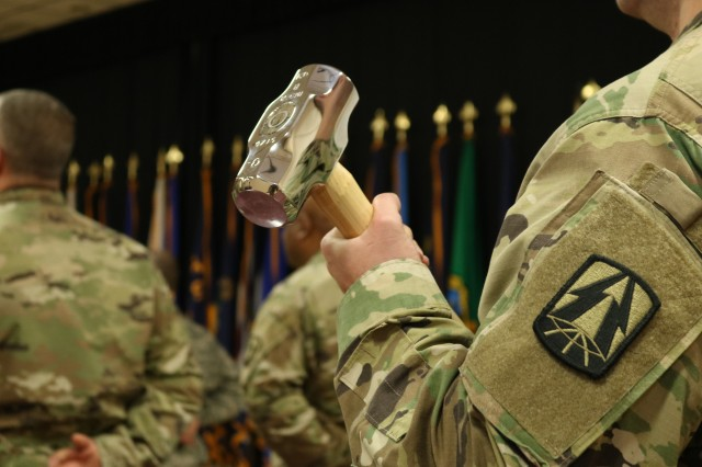 The Army Reserve Cyber Operations Group (ARCOG), 335th Signal Command (Theater), North East Cyber Protection Center (NECPC), recognize the Soldier's assigned to the NECPC's Cyber Protection Team 180 for achieving the required mission milestone of Initial Operating Capability (IOC) status for the ARCOG by presenting the CPT a symbolic representation of the cyber Hammer of Thor -- a symbol used by the Military Cyber Professionals Association to recognize high achievements in the cyber career field November 4 at Fort Devens, Massachusetts. The IOC ceremony held for CPT 180 is the start of a tradition to recognize this milestone status for ARCOG CPTs.