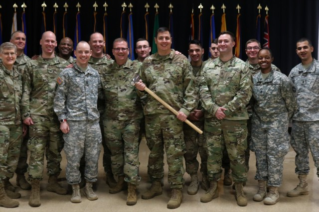 U.S. Army Col. Robert S. Powell, Jr., left, commander Army Reserve Cyber Operations Group (ARCOG), 335th Signal Command (Theater), and Maj. Adrian Edwards, leading officer for the ARCOG's North East Cyber Protection Center -- Cyber Protection Team 180, gather for a group photo after a ceremony to recognize the Soldier's assigned to the CPT for achieving the required mission milestone of Initial Operating Capability (IOC) status for the ARCOG. To celebrate this achievement ARCOG leaders presented the CPT a symbolic representation of the cyber Hammer of Thor -- a symbol used by the Military Cyber Professionals Association to recognize high achievements in the cyber career field. The IOC ceremony held for CPT 180 is the start of a tradition to recognize achievement of this milestone status ARCOG CPTs.