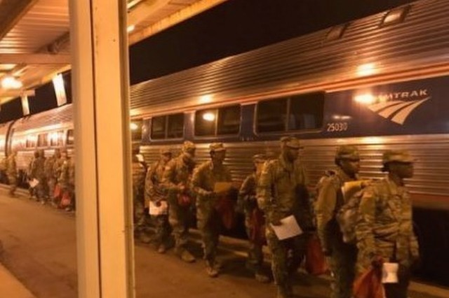 Soldiers training at Fort Jackson, S.C., prepare to board a train at the Columbia Amtrak station for Holiday Block Leave (HBL) early morning Dec. 19, 2018. The 369th Adjutant General Battalion, U.S. Army Soldier Support Institute, provided the mission command at the rail station. Each year during the Christmas and New Year holiday season, U.S. Army Combined Arms Support Command AIT schools conduct HBL to give military students and cadre downtime. (U.S. Army photo by Lt. Col. Dwayne L. Wade)