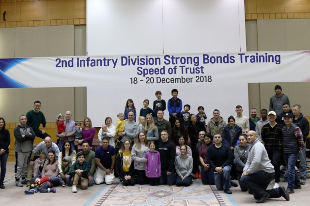 HONGCHEON, Republic of Korea - Soldiers throughout 2nd Infantry Division/ROK-U.S. Combined Division and family members pose for a group picture during a Strong Bonds family training event at Vivaldi Park Ski World Dec. 18-20. The event focused on building ready families through a series of lectures, presentations, group exercises, and conquering the slopes.