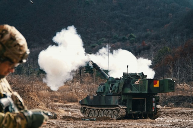 """CAMP HOVEY, Republic of Korea - A M109A6 Paladin fires a 155 mm inert training round during the 4th Battalion, 1st Field Artillery Regiment """"Defender,"""" 3rd Armored Brigade Combat Team, 1st Armored Division (Rotational) Table VI Gunnery at St. Barbara Range Dec. 5. Table VI Gunnery is an annual training requirement for Field Artillery units that qualify individual howitzer crews and platoon Fire Direction Centers. This training focuses on overall readiness and maintaining Field Artillery core competencies at the section level. (U.S. Army photo by 1st Lt. Sean M. Kealey)"""