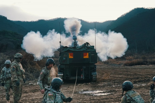 An M109A6 Paladin from C Battery, fires a 155mm inert training round during 4-1 Field Artillery Battalion's Table VI Gunnery, Dec. 5, at Firing Point 95, Republic of Korea. Table VI Gunnery is an annual training requirement for a Field Artillery unit that qualifies individual howitzer crews and platoon Fire Direction Centers. This training focuses on overall readiness and maintaining Field Artillery core competencies at the section level. (US Army photo by 1st. Lt. Sean M. Kealey)