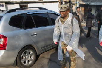 Soldiers bring gift of warmth to local residents
