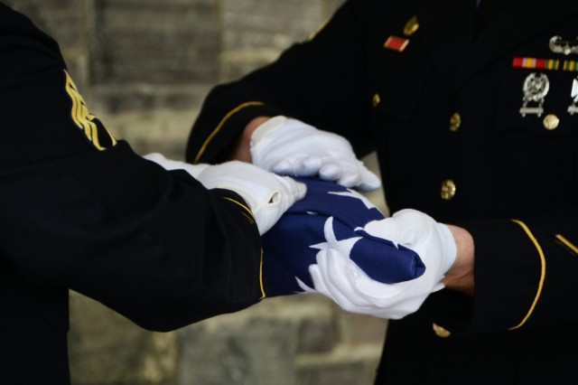 New York National Guard Staff Sgt. Raymond Rodriguez (left) and Sgt. Joshua Sanzo (left), members of the northern district Honor Guard, folds the American Flag during a funeral service, at the Gerald B. Solomon National Cemetery, Saratoga Springs, N.Y., June 6, 2018. The Soldiers were conducting the funeral services for the family of John Deule.