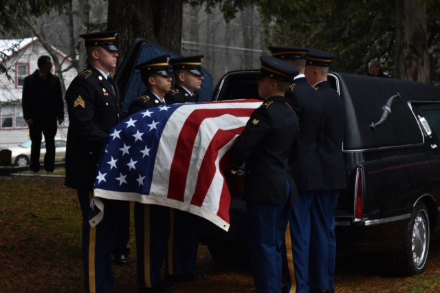 New York Army National Guard Soldiers in the Honor Guard carry the casket casket of Pfc. John Martin, Schuylerville, N.Y., Dec. 2, 2018. Martin had gone missing in action during the Korean War at the battle of Chosin Reservoir. His family had finally received his body after 68 years missing.