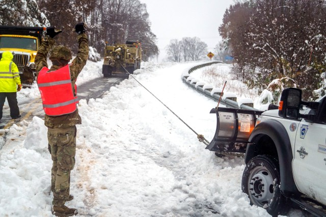 Soldiers with the North Carolina Army National Guard's 690th Brigade Support Battalion assist North Carolina Department of Transportation personnel with recovering snow plows and assisting stuck drivers during a winter storm, Dec. 9, 2018. The year kept National Guard members busy at home responding to snowstorms, wildfires, and hurricanes. Guard members also took part in joint and multinational training exercises, deployed overseas as part of contingency operations and celebrated milestones, such as the 25th anniversary of the Department of Defense's State Partnership Program, which pairs Guard elements with partner nations worldwide.
