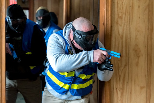 Law enforcement officers clear a building during an active shooter training scenario.