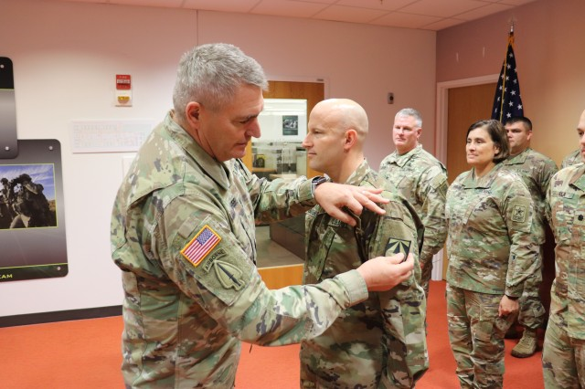 Maj. Gen. Peter Gallagher, Network CFT Director, presents the new Army Futures Command unit patch to Master Sgt. Charles Vaughn, N-CFT Operations Non-Commissioned Officer. (U.S. Army photo by Justin Eimers)