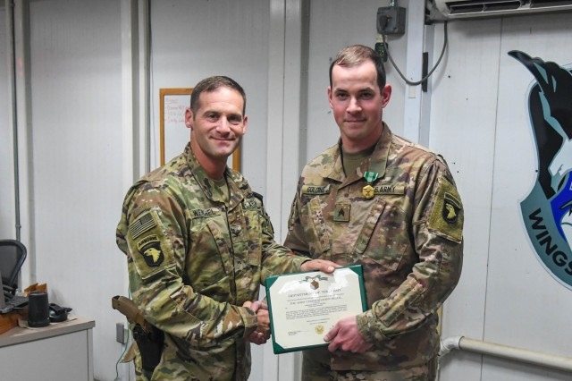 Col. Matthew R. Weinshel, commander of, Task Force Destiny, awards the Army Commendation Medal to Sgt. Joshua T. Golding at Bagram Airfield, Afghanistan Nov. 30, 2018. Golding served in TF Destiny's S-2 section as the geospacial imagery Noncommissioned Officer. Golding will continue to support operations from home station.