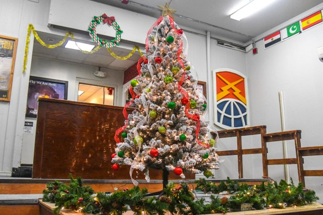 Task Force Destiny Soldiers bring the holiday cheer and spirit as they set up a Christmas tree for the TF Destiny building at Bagram Airfield, Afghanistan Dec. 6, 2018.