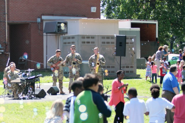 Members of the 101st Airborne Division (Air Assault) Jazz Band played music June 7 at Barkley Elementary School. The band provided musical support for the students and faculty in attendance at the school's closing ceremony. The school is relocating to a new upgraded 21st century learning style building. (Photo by Sgt. Steven E. Lopez, 40th Public Affairs Detachment, 101st Airborne Division (Air Assault))