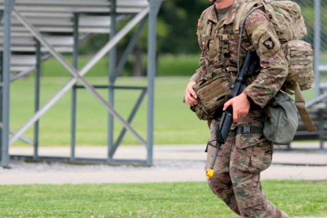 1st Lt. Michael Joslin, 101st Combat Aviation Brigade, 101st Airborne Division (Air Assault), reaches the finish line of the 12-mile foot march event during the Expert Field Medical Badge testing June 22, at Fort Campbell, Ky. Joslin finished with the fastest time, coming in at 2:35:00.
