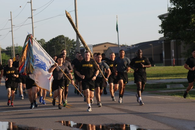 Brig. Gen. Kenneth T. Royar and Command Sgt. Maj. James L. Manning lead soldiers from 101st Airborne Division in a 4 mile division run for Week of the Eagles, May. 24 on Fort Campbell, Ky. Week of the Eagles was a tradition started in 1973 as an effort to reinvigorate the sense of community and is still carried on today to also honor those who served. (Photo by: Sgt. Sharifa Newton, 40th Public Affairs Detachment)