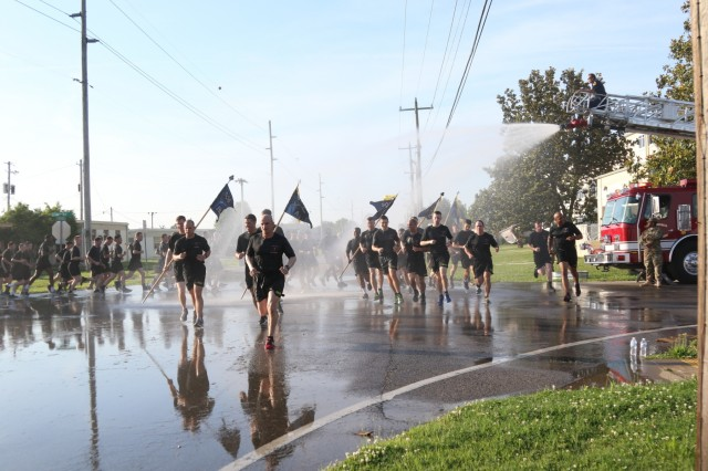 Soldiers from 101st Airborne Division, get sprayed by a hose as they run 4 miles in a division run for Week of the Eagles, May. 24 on Fort Campbell, Ky. Week of the Eagles was a tradition started in 1973 as an effort to reinvigorate the sense of community and is still carried on today to also honor those who served. (Photo by: Sgt. Sharifa Newton, 40th Public Affairs Detachment)
