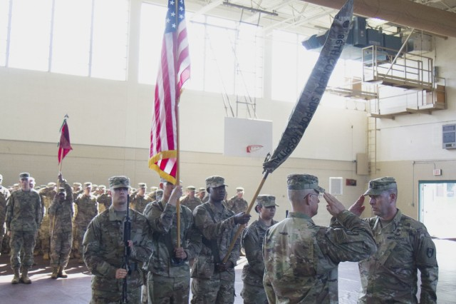 COL Bruce Syvinski (left), Commander of the 86th Combat Support Hospital ( Eagle Medics) and Command Sgt. Maj. Daryl Forsythe (right), Command Sergeant Major of the 86th CSH, render a salute to the cased colors of the 86th CSH. As the last deployment as the 86th CSH before transforming to the 86th Field Combat Hospital, the 86th CSH will embark on a nine month journey in the Middle East. (Photo by Sgt. Steven E. Lopez, 40th Public Affairs Detachment, 101st Airborne Division (Air Assault))