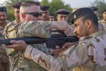 Soldiers provide marksmanship tips in Iraq