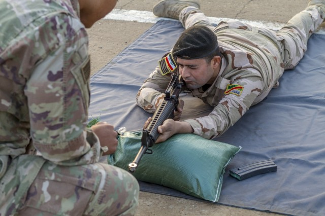 An Iraqi soldier conducts a dime/washer drill as part of a primary marksmanship instruction course at Camp Taji, Iraq, Dec.19. The course is taught by Task Force India Bravo, a unit comprised of Soldiers from 1st Squadron, 98th Cavalry Regiment, 106th Support Battalion and 2nd Battalion, 114th Field Artillery Regiment, 155th Armored Brigade Combat Team, Mississippi Army National Guard, and is deployed in support of Combined Joint Task Force - Operation Inherent Resolve, working with the Iraqi Security Forces to develop a sustainable and inclusive force that can secure its sovereign borders, protect the population, and ensure the lasting defeat of ISIS.