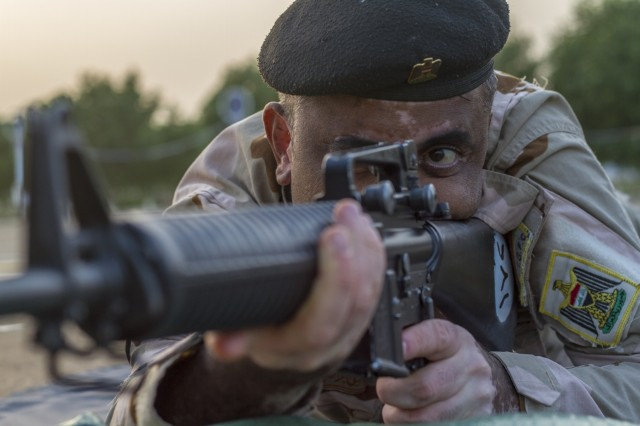 An Iraqi soldier conducts a dime/washer drill as part of a primary marksmanship instruction course held at Camp Taji, Iraq, Dec.19. The course is taught by Task Force India Bravo, a unit comprised of Soldiers from 1st Squadron, 98th Cavalry Regiment, 106th Support Battalion and 2nd Battalion, 114th Field Artillery Regiment, 155th Armored Brigade Combat Team, Mississippi Army National Guard, and is tasked with training the Iraqi 9th Armor Division. This Task Force is deployed in support of Combined Joint Task Force - Operation Inherent Resolve, working with the Iraqi Security Forces to develop a sustainable and inclusive force that can secure its sovereign borders, protect the population, and ensure the lasting defeat of ISIS.