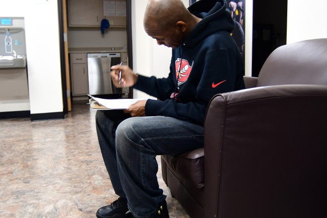 Sgt. 1st Class Rodney Hugan, an OC/T from 4409th Brigade Support Battalion, 4th Cavalry Multifunctional Training Brigade, fills out initial paperwork before participating in assessments and testing at the Fort Knox Army Wellness Center Dec. 27, 2018.