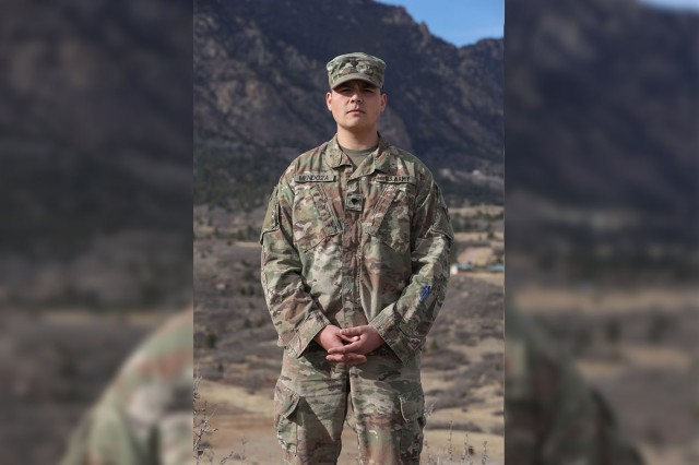 """Spc. Flavio Mendoza, assigned to the 22nd Human Resources Company, 4th Special Troops Battalion, 4th Sustainment Brigade, 4th Infantry Division, poses for a photo on Fort Carson, Colorado, Dec. 28, 2018. """"I still carry the engineer crest in my (patrol cap). It lets me know where I came from and that gives me pride,"""" said Mendoza. """"Even though I'm away and in a new career field, I will always be an engineer."""""""