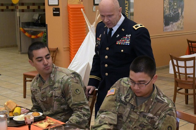 "Chaplain (Col) David VanderJagt visits with Soldiers at Fort Knox's Cantigny Dining Facility during Thanksgiving. VanderJagt's regular appearances with Soldiers and civilians or 'battlefield circulations' were a ""ministry of presence.""""People don't talk to strangers, and I never wanted to be one. Early on, I made it a point to reach out to people, and to do that I had to go to them,"" VanderJagt said."