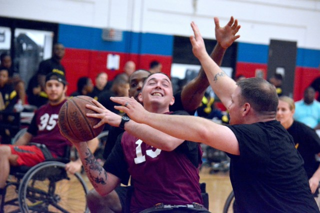 Carl R. Darnall Army Medical Center Troop Command and Warrior Transition Unit battle for the ball during WTU's wheelchair basketball tourney. The annual event was held November 30 at Fort hood's Abrams Gym in honor of November's Warrior Care Month.
