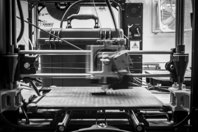 The U.S. Army's first 3D printer, operated by U.S. Army Soldiers assigned to 194th Combat Sustainment Support Battalion, 2nd Sustainment Brigade, 520th Support Maintenance Company, prints a an ignition switch for a Humvee, on Camp Humphreys, Republic of Korea, Oct. 29, 2018. The printer has the capability of manufacturing objects made of carbon fiber, fiberglass, and Kevlar. (U.S. Army photo by Spc. Adeline Witherspoon, 2nd SBDE PAO)