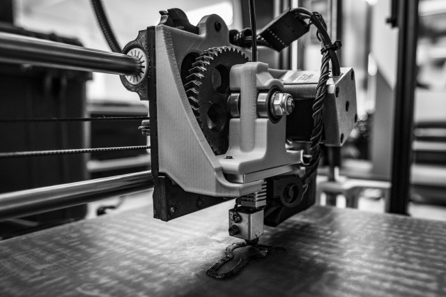The U.S. Army's first 3D printer, operated by Soldiers assigned to 194th Combat Sustainment Support Battalion, 2nd Sustainment Brigade, 520th Support Maintenance Company, manufactures an ignition switch for a Humvee, on Camp Humphreys, Republic of Korea, Oct. 29, 2018. The printer uses the method of additive manufacturing, which is the process of building a 3D structure by introducing material to a space that previously had none. (U.S. Army photo by Spc. Adeline Witherspoon, 2nd SBDE PAO)